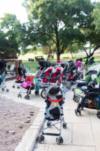 Strollers pile up at YoungLives Camp Buckner while teen mothers learn about Jesus