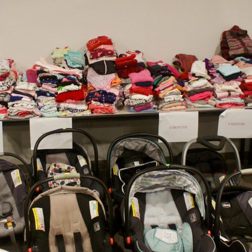 Volunteers organize hundreds of donations for placement in The Mama Store at Aggieland Pregnancy Outreach
